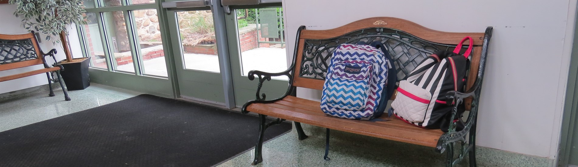 backpacks on bench in WCMS lobby